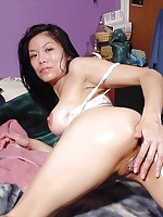 Asian spreads her pussy and deeply finger it